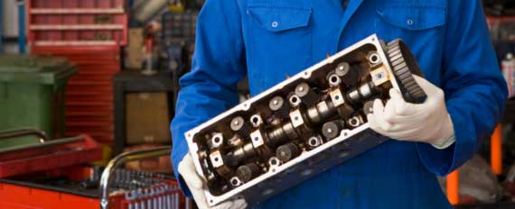 mechanic holding cylinder head
